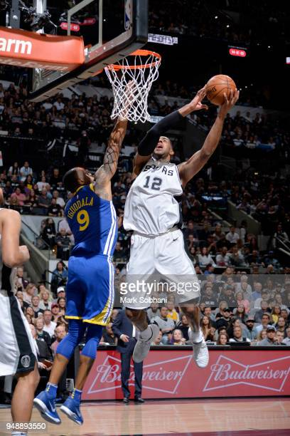 LaMarcus Aldridge of the San Antonio Spurs goes to the basket against the Golden State Warriors during Game Three of the Western Conference...