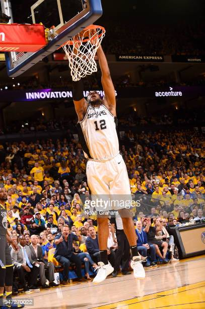 LaMarcus Aldridge of the San Antonio Spurs goes up for a dunk against the Golden State Warriors in Game Two of Round One of the 2018 NBA Playoffs on...