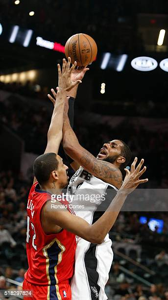 LaMarcus Aldridge of the San Antonio Spurs goes up for a shot against Alexis Ajinca of the New Orleans Pelicans at ATT Center on March 30 2016 in San...