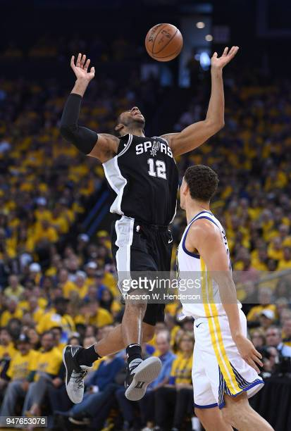 LaMarcus Aldridge of the San Antonio Spurs goes up to shoot and gets fouled by Klay Thompson of the Golden State Warriors in the second quarter...