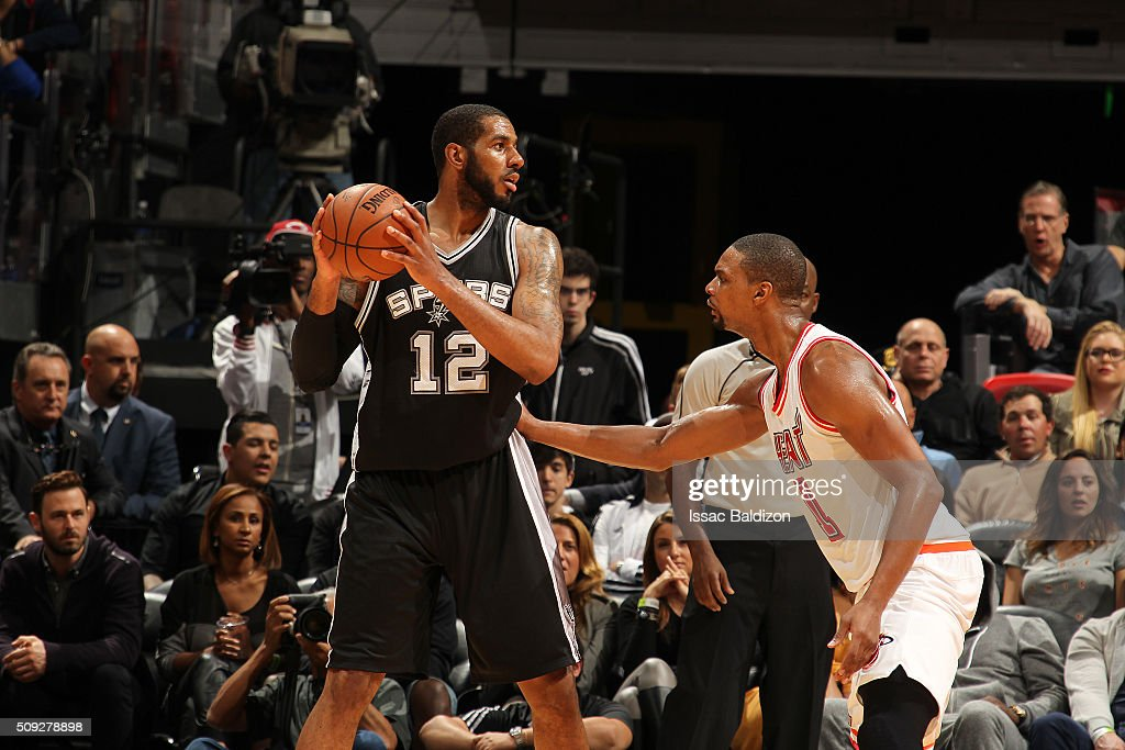 LaMarcus Aldridge #12 of the San Antonio Spurs handles the ball against Chris Bosh #1 of the Miami Heat on February 9, 2016 at American Airlines Arena in Miami, Florida.