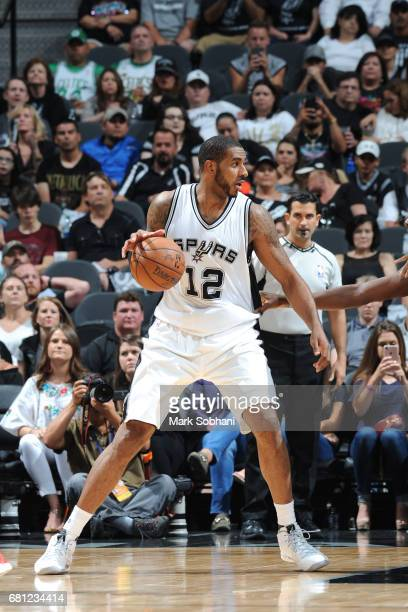 LaMarcus Aldridge of the San Antonio Spurs handles the ball against the Houston Rockets in Game Five of the Western Conference Semifinals on May 9...