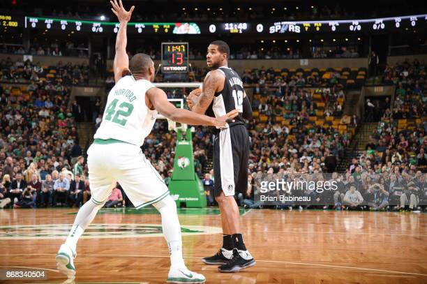 LaMarcus Aldridge of the San Antonio Spurs handles the ball against the Boston Celtics on October 30 2017 at the TD Garden in Boston Massachusetts...