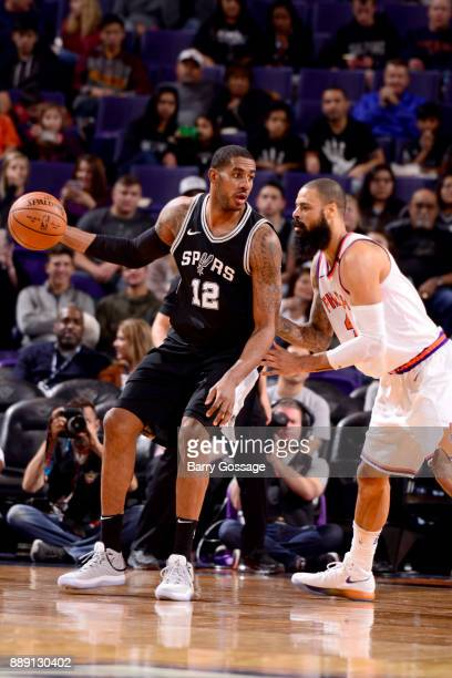 LaMarcus Aldridge of the San Antonio Spurs handles the ball against the Phoenix Suns on December 9 2017 at Talking Stick Resort Arena in Phoenix...