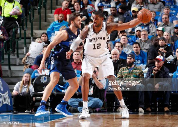 LaMarcus Aldridge of the San Antonio Spurs handles the ball against the Dallas Mavericks on December 12 2017 at the American Airlines Center in...