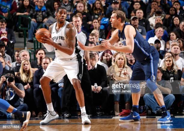 LaMarcus Aldridge of the San Antonio Spurs handles the ball against Dirk Nowitzki of the Dallas Mavericks on December 12 2017 at the American...