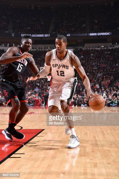 LaMarcus Aldridge of the San Antonio Spurs handles the ball against Clint Cappella of the Houston Rockets on December 15 2017 at the Toyota Center in...