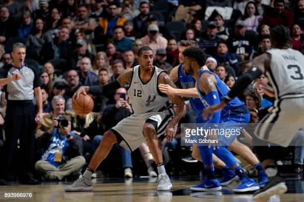 LaMarcus Aldridge of the San Antonio Spurs handles the ball against the Dallas Mavericks on December 16 2017 at the ATT Center in San Antonio Texas...