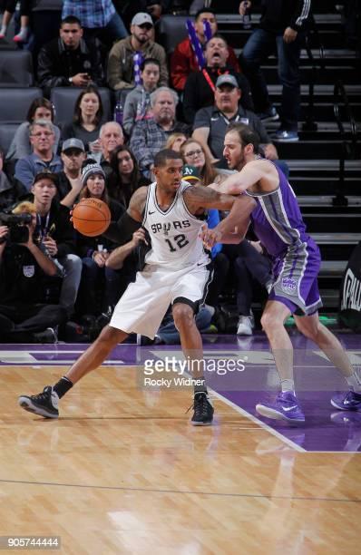 LaMarcus Aldridge of the San Antonio Spurs handles the ball against Kosta Koufos of the Sacramento Kings on January 8 2018 at Golden 1 Center in...