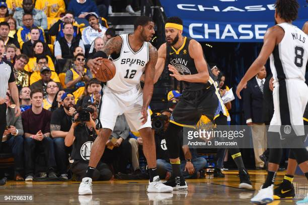 LaMarcus Aldridge of the San Antonio Spurs handles the ball against the Golden State Warriors in Game Two of Round One of the 2018 NBA Playoffs on...