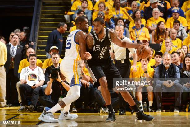 LaMarcus Aldridge of the San Antonio Spurs handles the ball during the game against the Golden State Warriors during Game Two of the Western...
