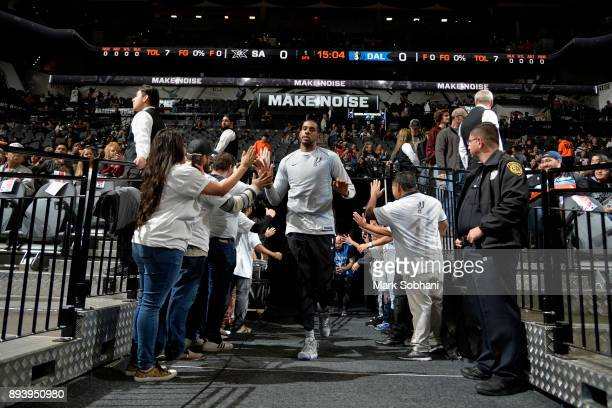 LaMarcus Aldridge of the San Antonio Spurs high fives fans before the game against the Dallas Mavericks on December 16 2017 at the ATT Center in San...