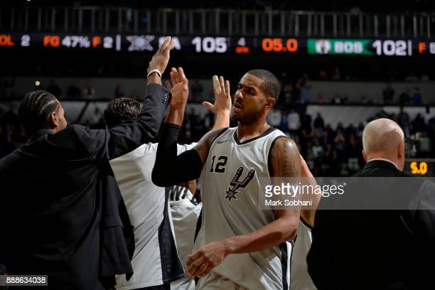LaMarcus Aldridge of the San Antonio Spurs high fives his teammates after the game against the Boston Celtics on December 8 2017 at the ATT Center in...