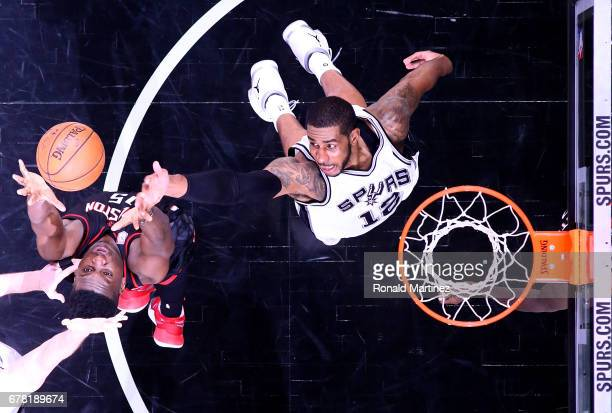 LaMarcus Aldridge of the San Antonio Spurs jumps for a rebound against Clint Capela of the Houston Rockets during Game Two of the NBA Western...