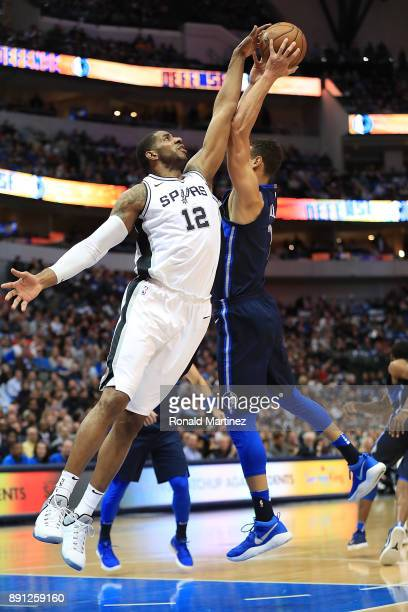 LaMarcus Aldridge of the San Antonio Spurs jumps for a rebound against Dwight Powell of the Dallas Mavericks at American Airlines Center on December...