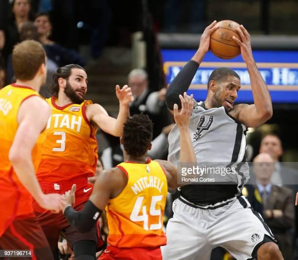 LaMarcus Aldridge of the San Antonio Spurs moves to score against Ricky Rubio of the Utah jazz and Donovan Mitchell of the Utah jazzat ATT Center on...