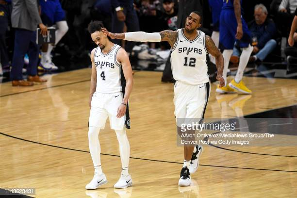 LaMarcus Aldridge of the San Antonio Spurs pats the head of Derrick White after he went off for a monster half against the Denver Nuggets during the...