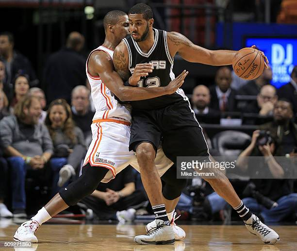 LaMarcus Aldridge of the San Antonio Spurs posts up Chris Bosh of the Miami Heat during a game at American Airlines Arena on February 9 2016 in Miami...