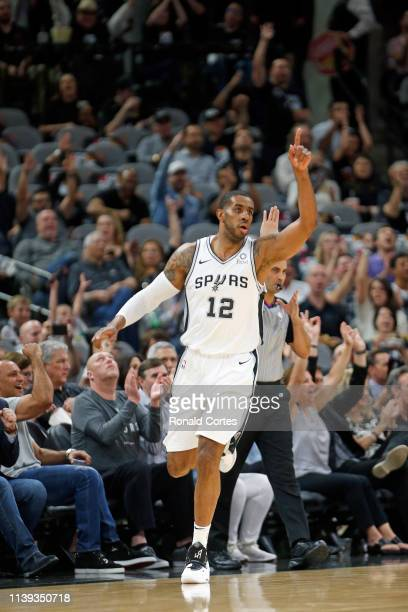 LaMarcus Aldridge of the San Antonio Spurs receives celebration from bench and fans after scoring against the Denver Nuggets during Game Six of the...
