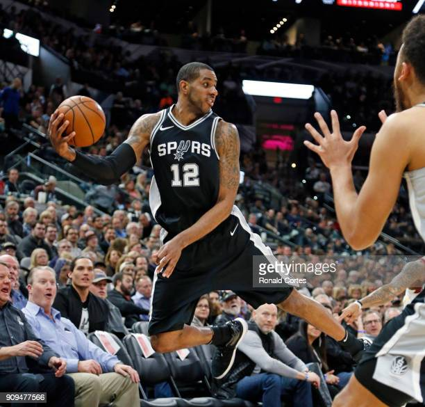 LaMarcus Aldridge of the San Antonio Spurs saves the ball from going out of bounds during game against the Cleveland Cavaliers at ATT Center on...