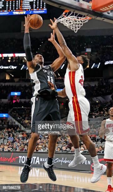 LaMarcus Aldridge of the San Antonio Spurs scores over Justise Winslow of the Miami Heat at ATT Center on December 06 2017 in San Antonio Texas NOTE...