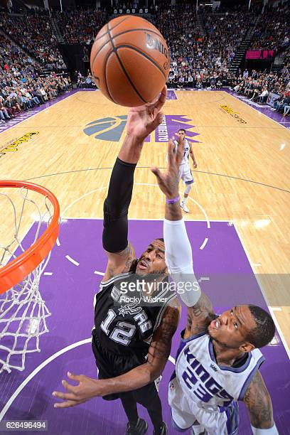 LaMarcus Aldridge of the San Antonio Spurs shoots against Ben McLemore of the Sacramento Kings on November 16 2016 at Golden 1 Center in Sacramento...