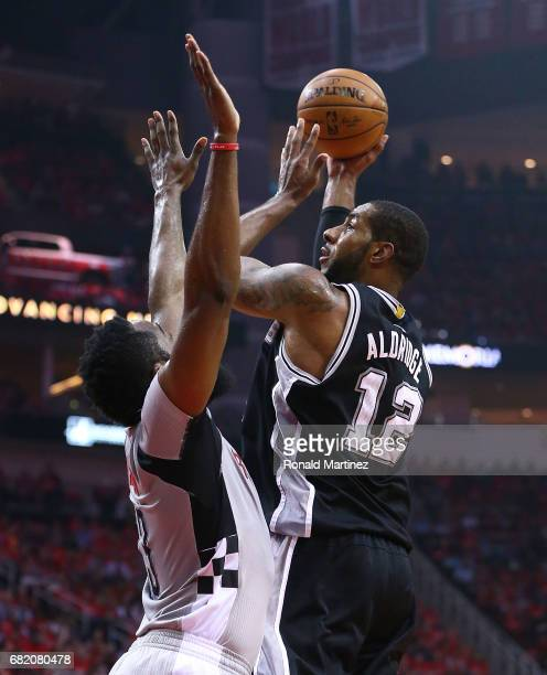 LaMarcus Aldridge of the San Antonio Spurs shoots against James Harden of the Houston Rockets during Game Six of the NBA Western Conference...