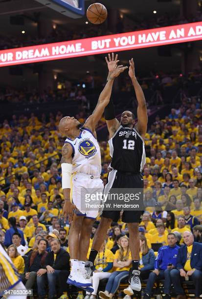 LaMarcus Aldridge of the San Antonio Spurs shoots over David West of the Golden State Warriors in the second quarter during Game One of the first...