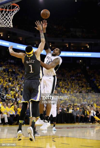 LaMarcus Aldridge of the San Antonio Spurs shoots over JaVale McGee of the Golden State Warriors during Game 2 of Round 1 of the 2018 NBA Playoffs at...