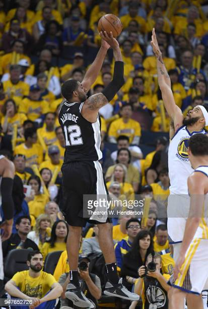 LaMarcus Aldridge of the San Antonio Spurs shoots over JaVale McGee of the Golden State Warriors in the third quarter during Game One of the first...