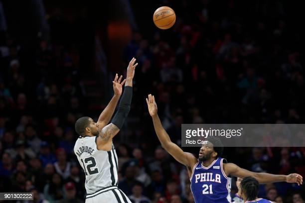 LaMarcus Aldridge of the San Antonio Spurs shoots over Joel Embiid of the Philadelphia 76ers at Wells Fargo Center on January 3 2018 in Philadelphia...