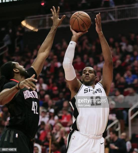 LaMarcus Aldridge of the San Antonio Spurs shoots over Nene Hilario of the Houston Rockets at Toyota Center on December 15 2017 in Houston Texas NOTE...