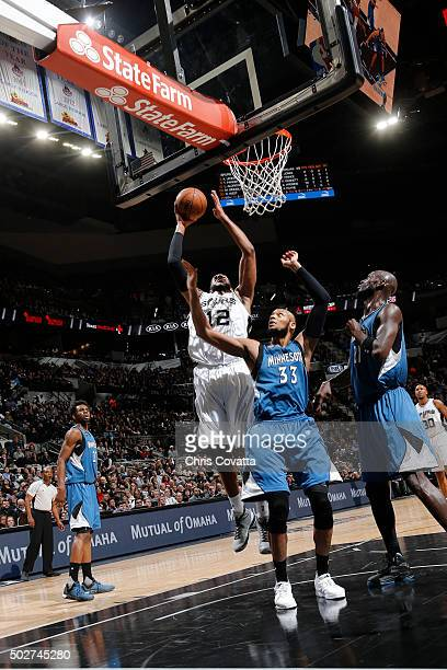 LaMarcus Aldridge of the San Antonio Spurs shoots the ball against the Minnesota Timberwolves on December 28 2015 at the ATT Center in San Antonio...
