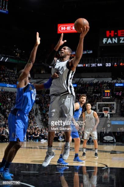 LaMarcus Aldridge of the San Antonio Spurs shoots the ball against the Dallas Mavericks on December 16 2017 at the ATT Center in San Antonio Texas...