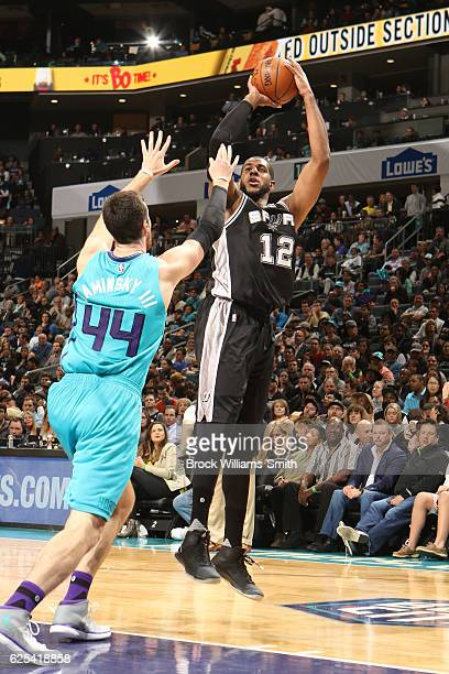 LaMarcus Aldridge of the San Antonio Spurs shoots the ball over Frank Kaminsky III of the Charlotte Hornets during a game on November 23 2016 at the...