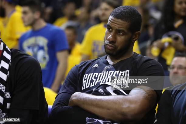 LaMarcus Aldridge of the San Antonio Spurs sits on the bench in the final minutes of their 136100 loss to the Golden State Warriors in Game Two of...