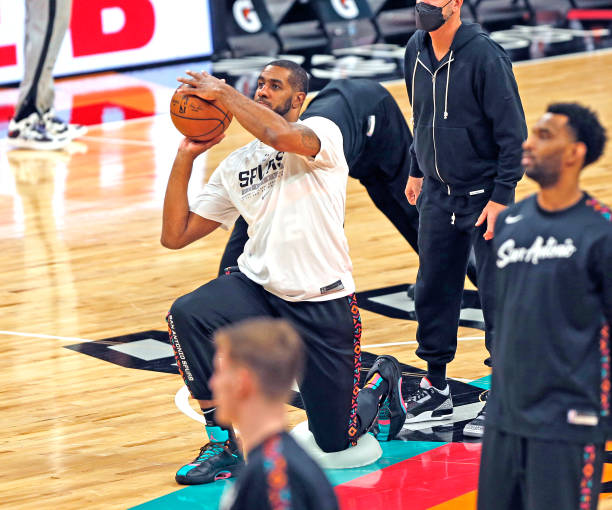 LaMarcus Aldridge of the San Antonio Spurs takes a half court shot from near half court as part of his routine before the start of their game against...