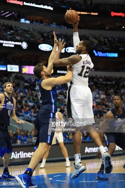 LaMarcus Aldridge of the San Antonio Spurs takes a shot against Maximilian Kleber of the Dallas Mavericks at American Airlines Center on December 12...