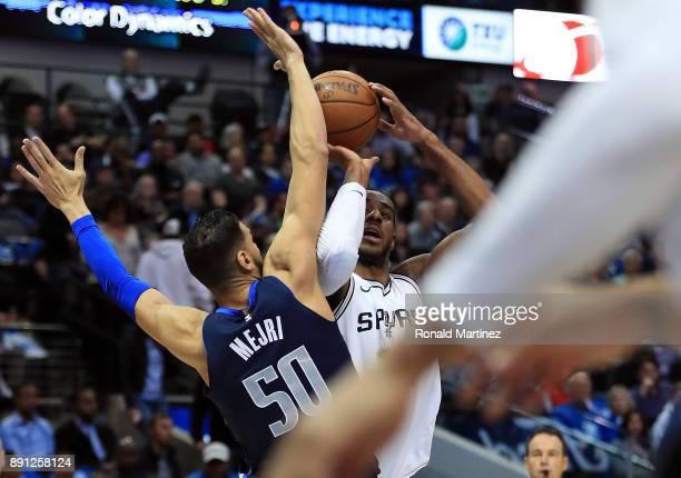 LaMarcus Aldridge of the San Antonio Spurs takes a shot against Salah Mejri of the Dallas Mavericks at American Airlines Center on December 12 2017...