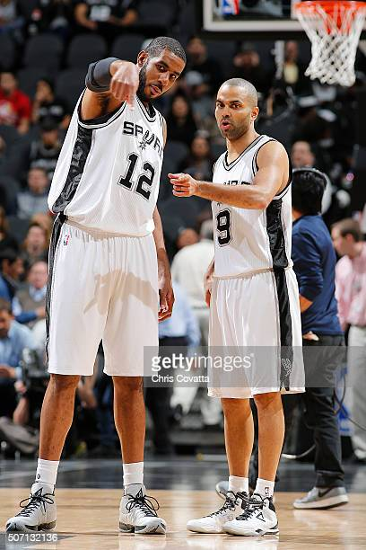LaMarcus Aldridge of the San Antonio Spurs talks with Tony Parker of the San Antonio Spurs before the game against the Houston Rockets on January 27...