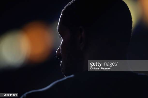 LaMarcus Aldridge of the San Antonio Spurs watches from the bench during the second half of the NBA game against the Phoenix Suns at Talking Stick...