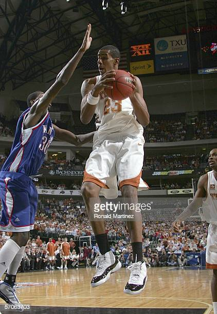 LaMarcus Aldridge of the Texas Longhorns goes up against Julian Wright of the Kansas Jayhawks during the final of the Phillips 66 Big 12 Men's...