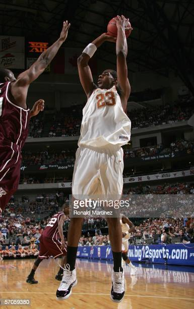 LaMarcus Aldridge of the Texas Longhorns shoots the jump shot against the Texas A&M Aggies during the semifinals round of the Phillips 66 Big 12...