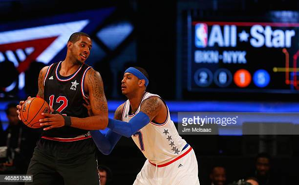 LaMarcus Aldridge of the Western Conference in action against Carmelo Anthony of the Eastern Conference during the 2015 NBA AllStar Game at Madison...