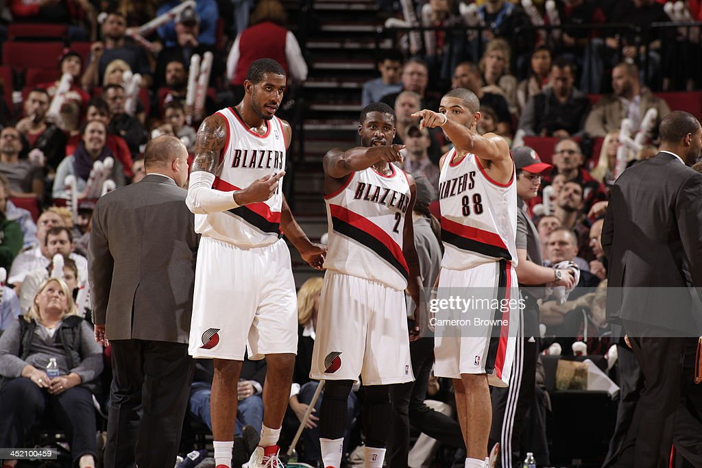 LaMarcus Aldridge #12, Wesley Matthews #2 and Nicolas Batum #88 of the Portland Trail Blazers walk off court against the Detroit Pistons on November 11, 2013 at the Moda Center Arena in Portland, Oregon.
