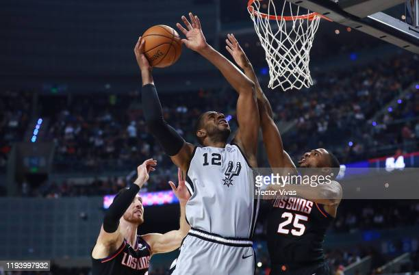 LaMarcus Aldrige of the San Antonio Spurs shoots the ball against Mikal Bridges of the Phoenix Suns and Frank Kaminsky of the Phoenix Suns during a...