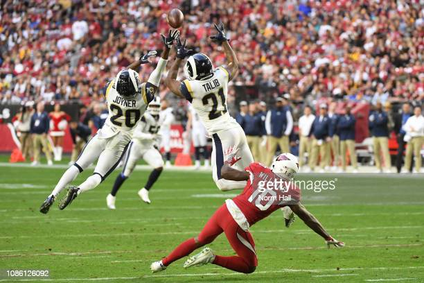 Lamarcus Joyner and Aqib Talib of the Los Angeles Rams break up a pass intended for Chad Williams of the Arizona Cardinals in the second half of the...