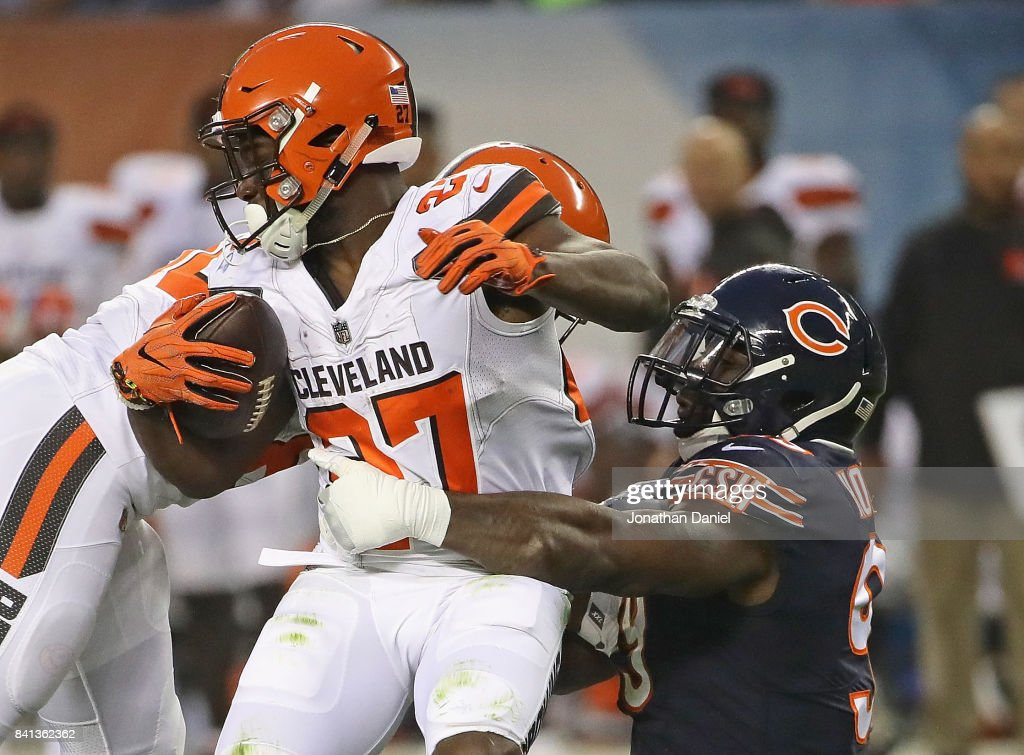 Lamarr Houston #99 of the Chicago Bears brings down Matt Dayes #27 of the Cleveland Browns during a preseason game at Soldier Field on August 31, 2017 in Chicago, Illinois.