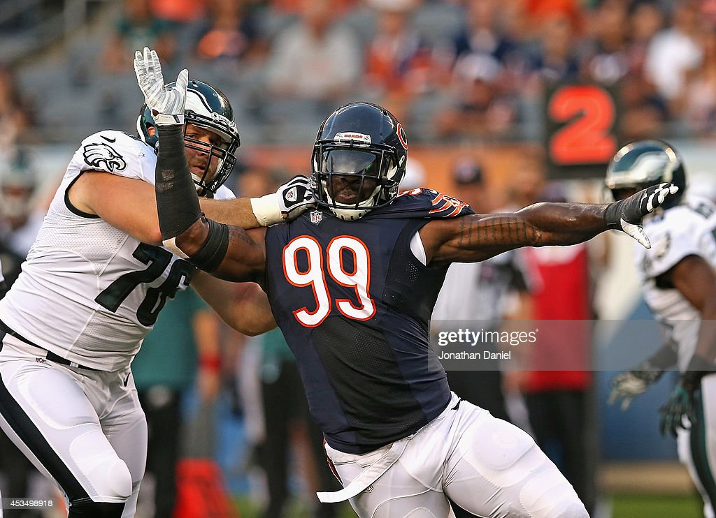 Lamarr Houston #99 of the Chicago Bears rushes against Allen Barbre #76 of the Philadelphia Eagles during a preseason game at Soldier Field on August 8, 2014 in Chicago, Illinois.