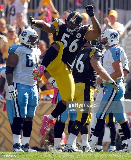 LaMarr Woodley of the Pittsburgh Steelers celebrates a sack against the Tennessee Titans during the game on October 9 2011 at Heinz Field in...